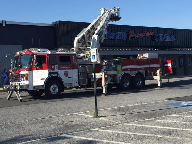 Fire crews examine a faulty air conditioning unit that cause the evacuation of Flagship Premium Cinemas Palmyra on Monday afternoon.
