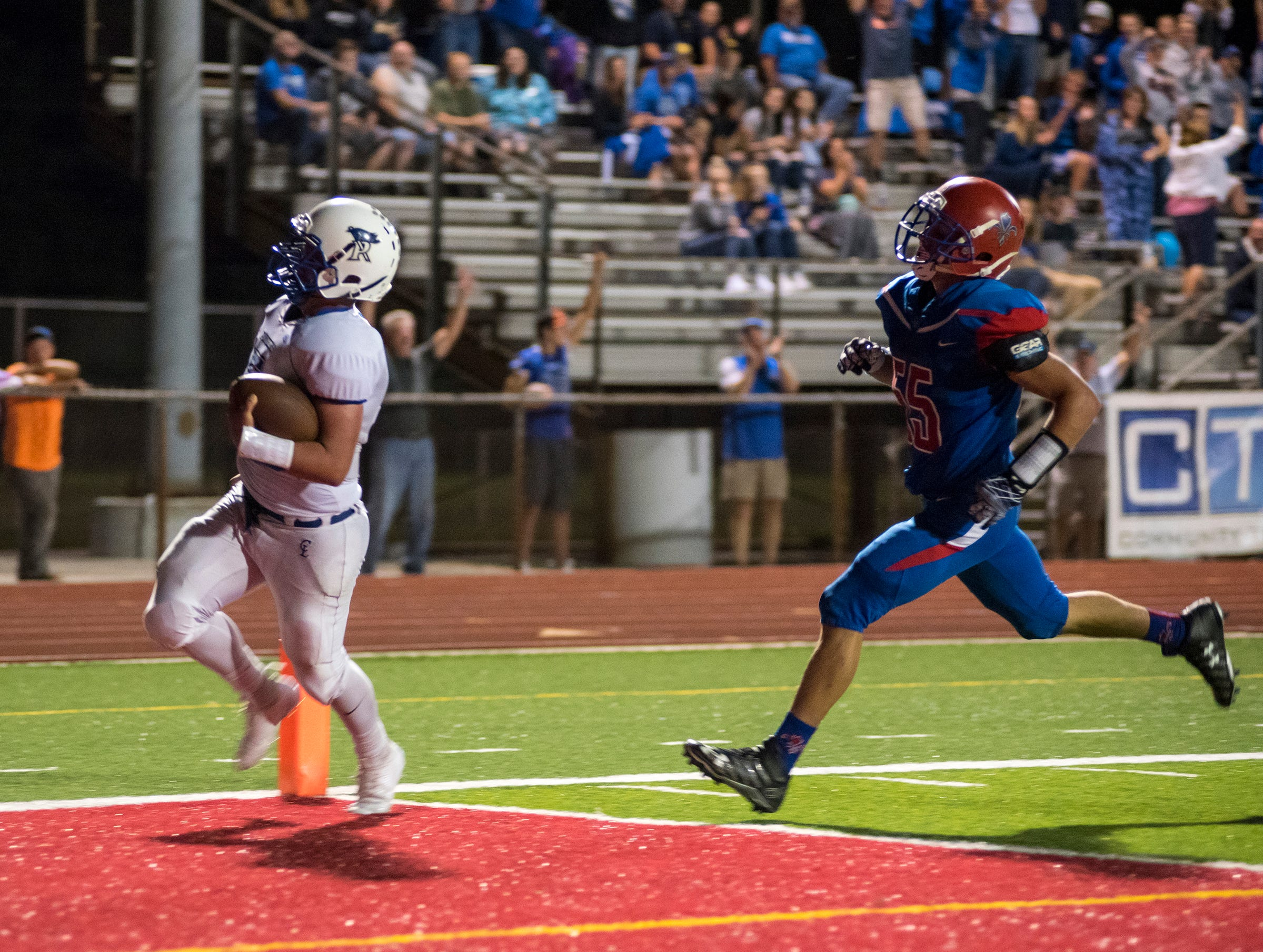 Cros-Lex High School quarterback Joey Johnston completes a 34-yard run for a touchdown during their game against St. Clair High School Thursday, Aug. 23, 2018. Johnston's touchdown brought the Pioneers to 20-21.