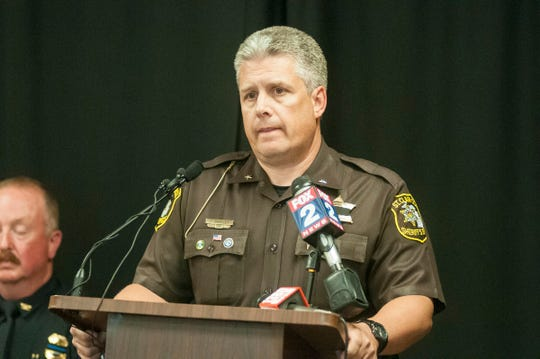 St. Clair County Undersheriff Tom Buckley reads a statement at a press conference Friday, Aug. 24, 2018, regarding an overnight shooting in Clyde Township that killed an off-duty Port Huron police officer. Port Huron Police Lt. Joel Wood was found dead at the scene.