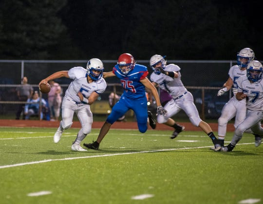 Cros-Lex High School quarterback Joey Johnston (5) runs the ball Thursday, Aug. 23, 2018, during their game against St. Clair High School at East China Stadium.