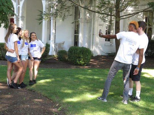 A group of student orientation leaders hang out and take photos on Thursday at Wilson College in Chambersburg. New and returning students arrived at the Philadelphia Avenue campus this week ahead of the first day of classes on Monday.