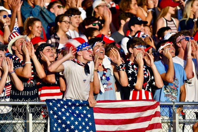 Central York's student section cheers as Central York hosts West York during football action at Central York High School in Springettsbury Township, Friday, Aug. 25, 2018.