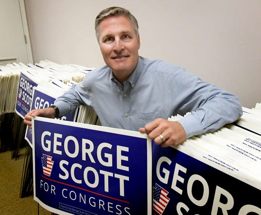U.S. congressional candidate George Scott poses with campaign lawn signs at his headquarters in Harrisburg on Friday, Aug. 24, 2018. He is attempting to oust incumbent Rep. Scott Perry in the 10th District. Bill Kalina photo