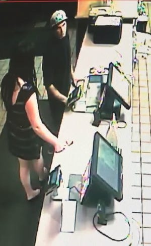 A surveillance photo showing a man and woman, who were suspected of swiping donations from the countertop at a McDonald's fast food restaurant in Sun Valley.