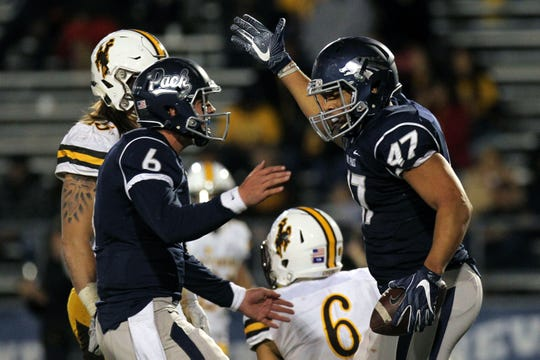 Ty Gangi celebrates with Jarred Gipson after taking over for an injured Tyler Stewart against Wyoming in 2016.