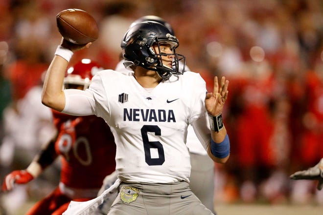 Nevada quarterback Ty Gangi readies to throw a pass against Fresno State last season.
