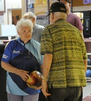 Alice Burnett talks with another bowler in the senior league.