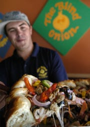 A slice of pizza is shown at a Blind Onion Pizza in Reno in this file photo.