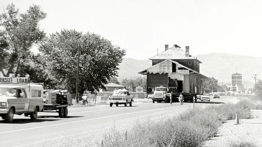 A historic photo of the city's depot being moved in 1986.