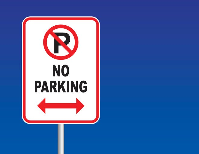 Vector of a Isolated No Parking sign on blue sky background.
