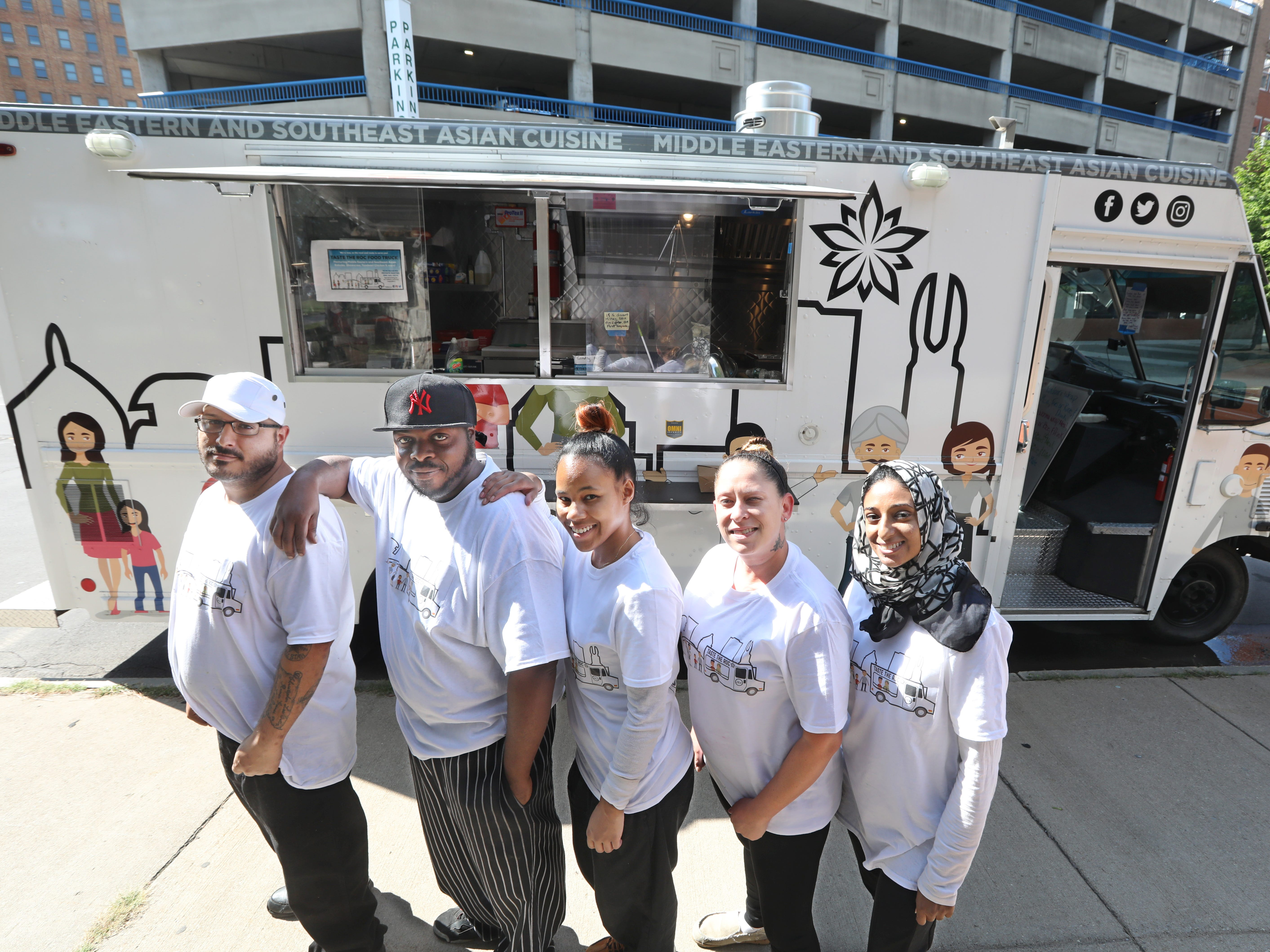 Co-owner Nishat Khan, far right, stands with her crew at her new Taste the ROC food truck in downtown Rochester.  Pictured from left are Raul Ortiz, Wilmer King, Jojo De La Cruz and Kaela Morrill.