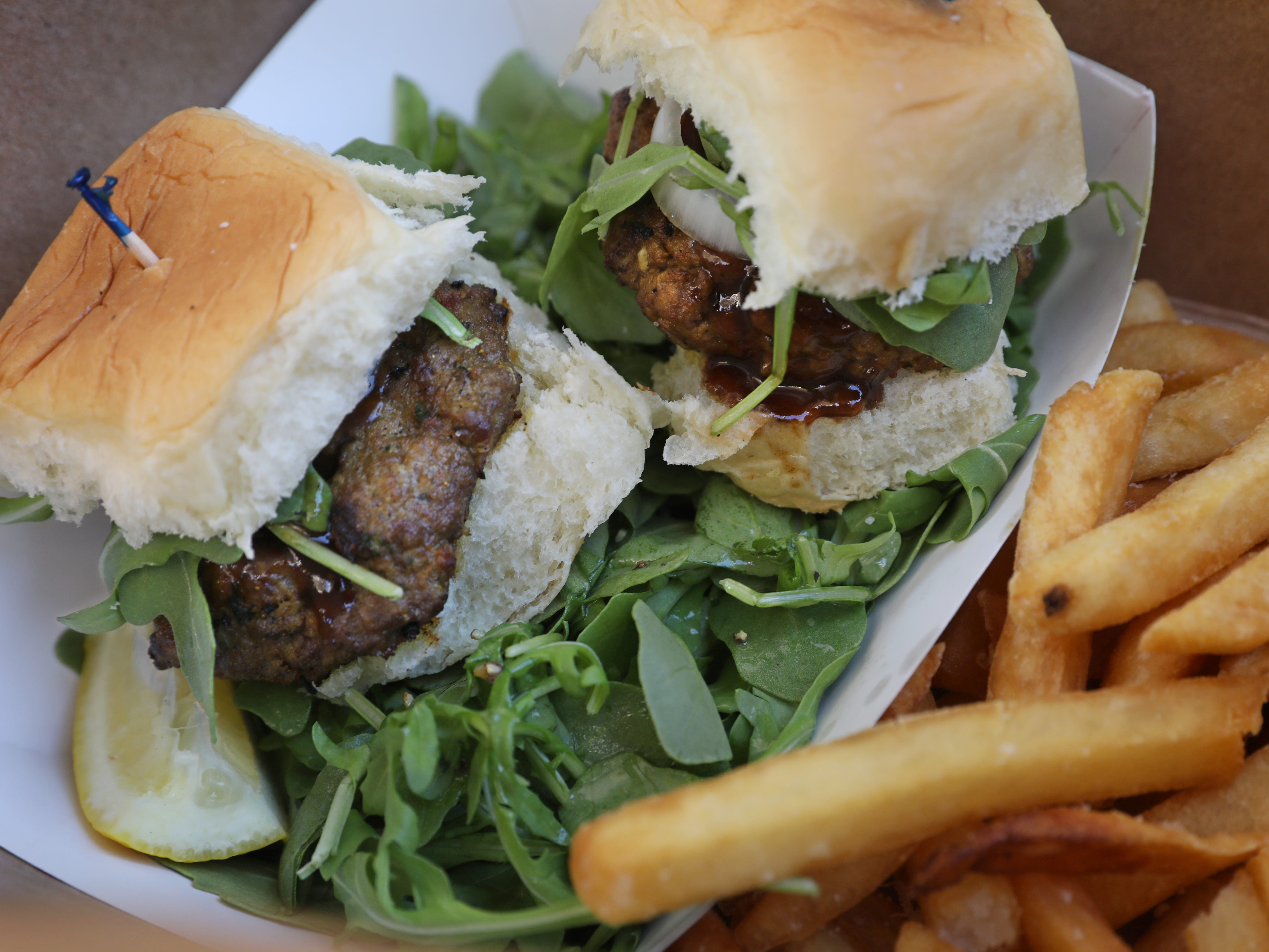 Chapli kabab sliders are served with fries and a salad.
