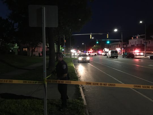 A Rochester police officer tapes off the scene on Dewey Avenue Thursday night. (Aug. 23, 2018)