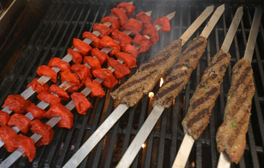 Skewers of Tandoori chicken and beef kabob are grilled in the Taste the ROC food truck.