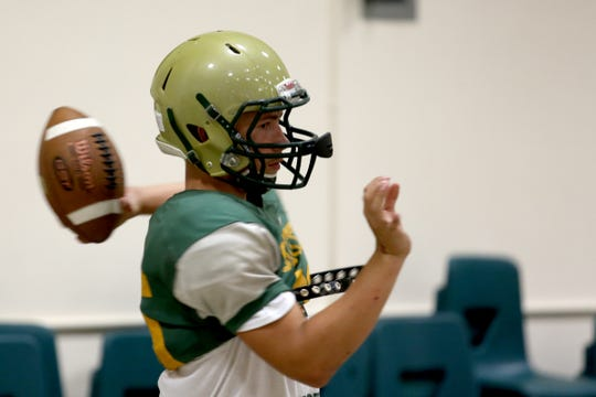 Tyler Kynaston practices with the McKay football team inside as wildfire smoke lingers over the Willamette Valley at McKay High School in Salem on Thursday, Aug. 23, 2018.