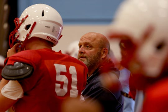 South Salem head coach Scott Dufault leads a football practice inside as wildfire smoke lingers over the Willamette Valley at South Salem High School on Thursday, Aug. 23, 2018.