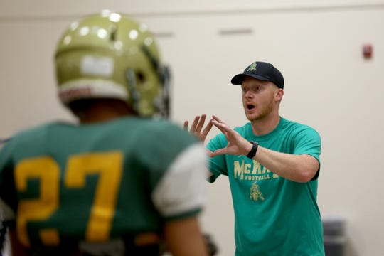 McKay head coach Josh Riddell leads a football practice inside as wildfire smoke lingers over the Willamette Valley at McKay High School in Salem on Thursday, Aug. 23, 2018.