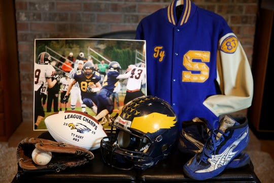 Ty Hart's Stayton High School sports equipment at his parents' home in Aumsville on Friday, Aug. 24, 2018. Lance Cpl. Ty Hart was one of 12 Marines who died in 2016 when two military helicopters collided during a training exercise in Hawaii. His family started a scholarship in his name so children and their families can afford to pay for sports equipment or training.