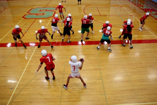 The South Salem football team practices inside as wildfire smoke lingers over the Willamette Valley at South Salem High School on Thursday, Aug. 23, 2018.