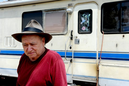 Charlie Creel stands outside his RV, in which he lives, behind Motel 6 near the Salinas airport.