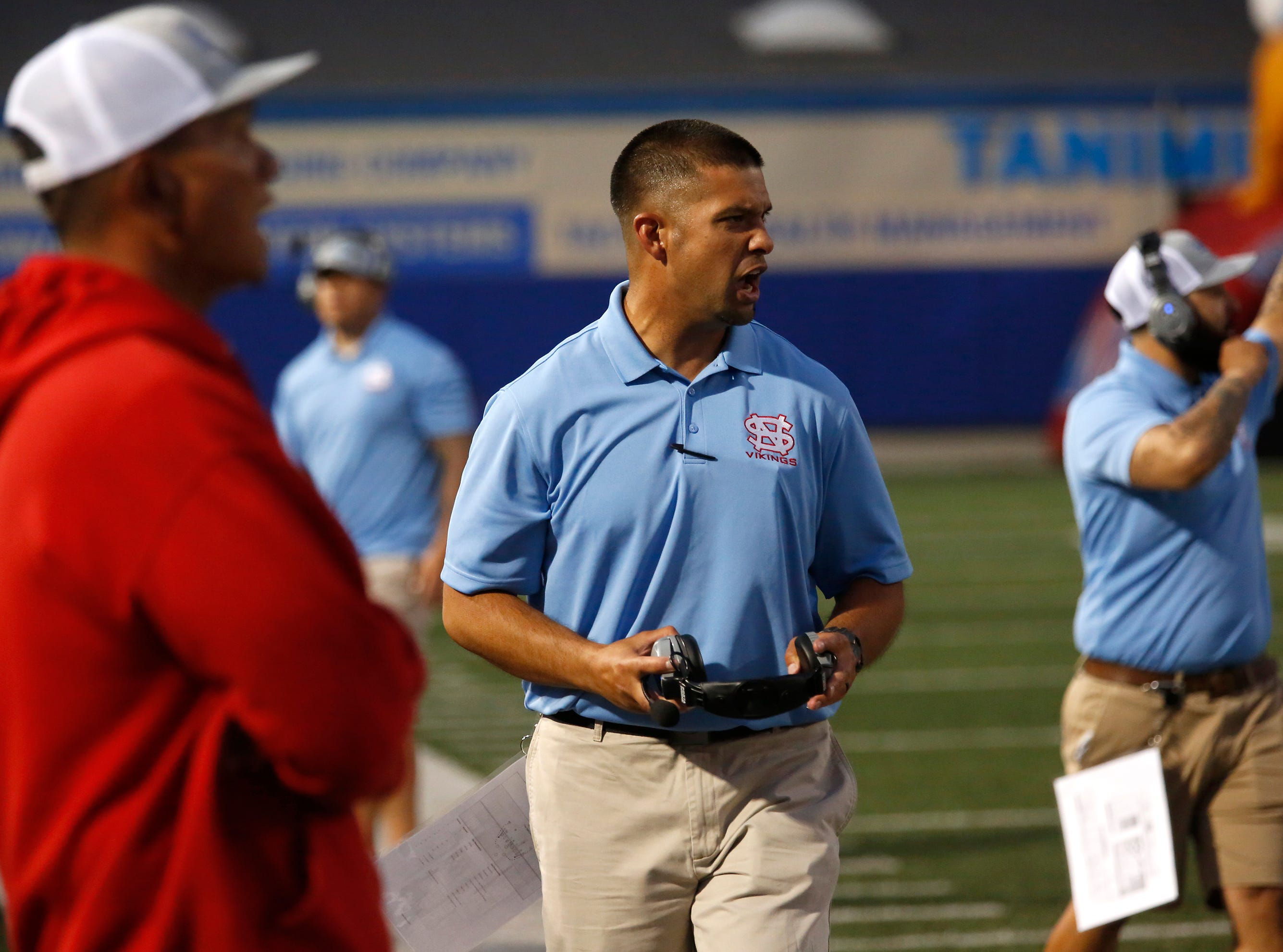 North Salinas's coach yells instructions to his team against North Monterey County during football at Rabobank Stadium in Salinas on Thursday August 23, 2018.