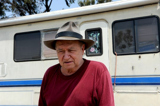 Charlie Creel, a veteran, stands outside his RV, in which he lives, behind Motel 6 near the Salinas airport.