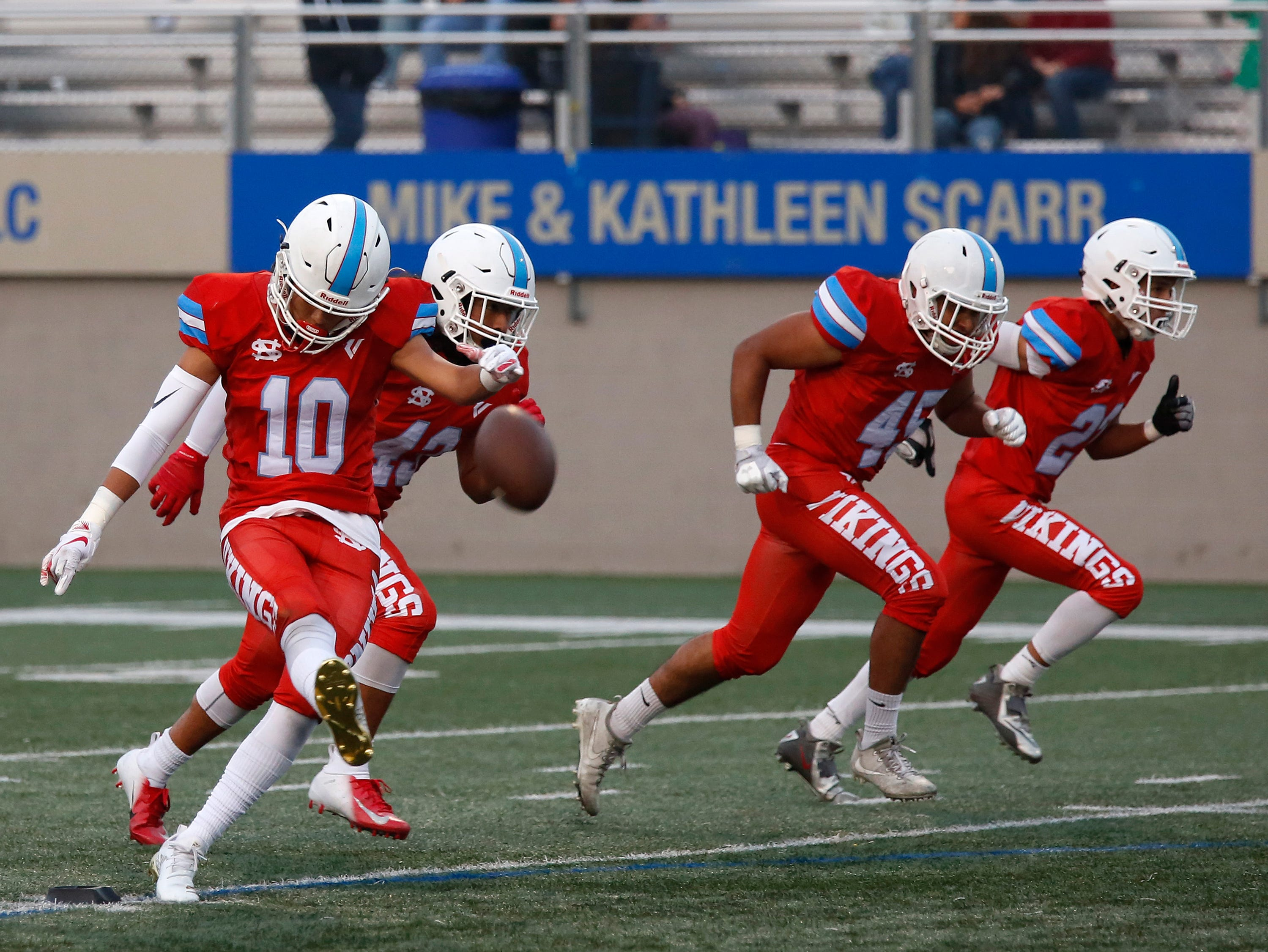 North Salinas's Brandon Guzman kicks off against North Monterey County during football at Rabobank Stadium in Salinas on Thursday August 23, 2018.