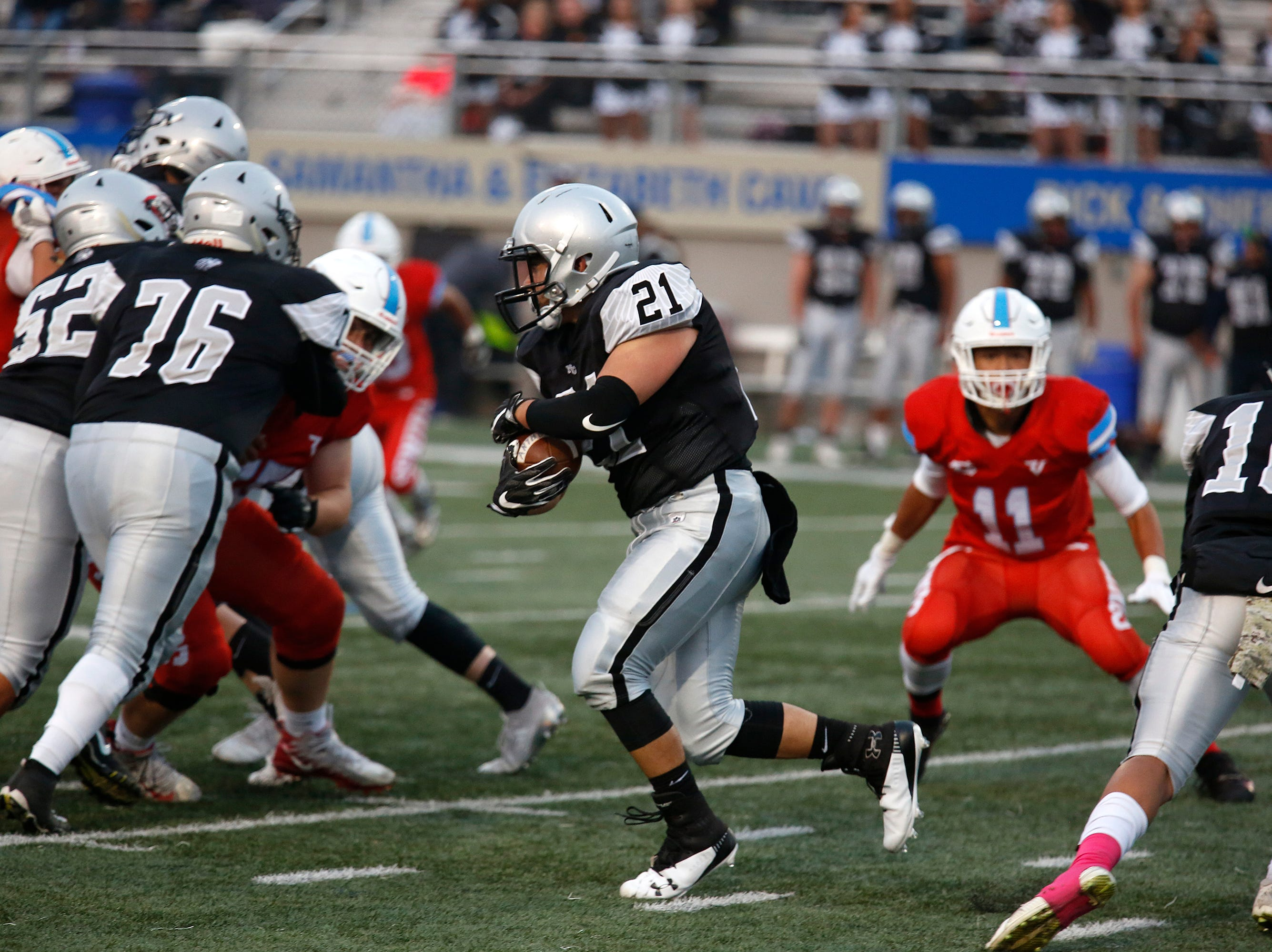 North Monterey County's Andrew Jara-Rodriguez finds an opening against North Salinas during football at Rabobank Stadium in Salinas on Thursday August 23, 2018.