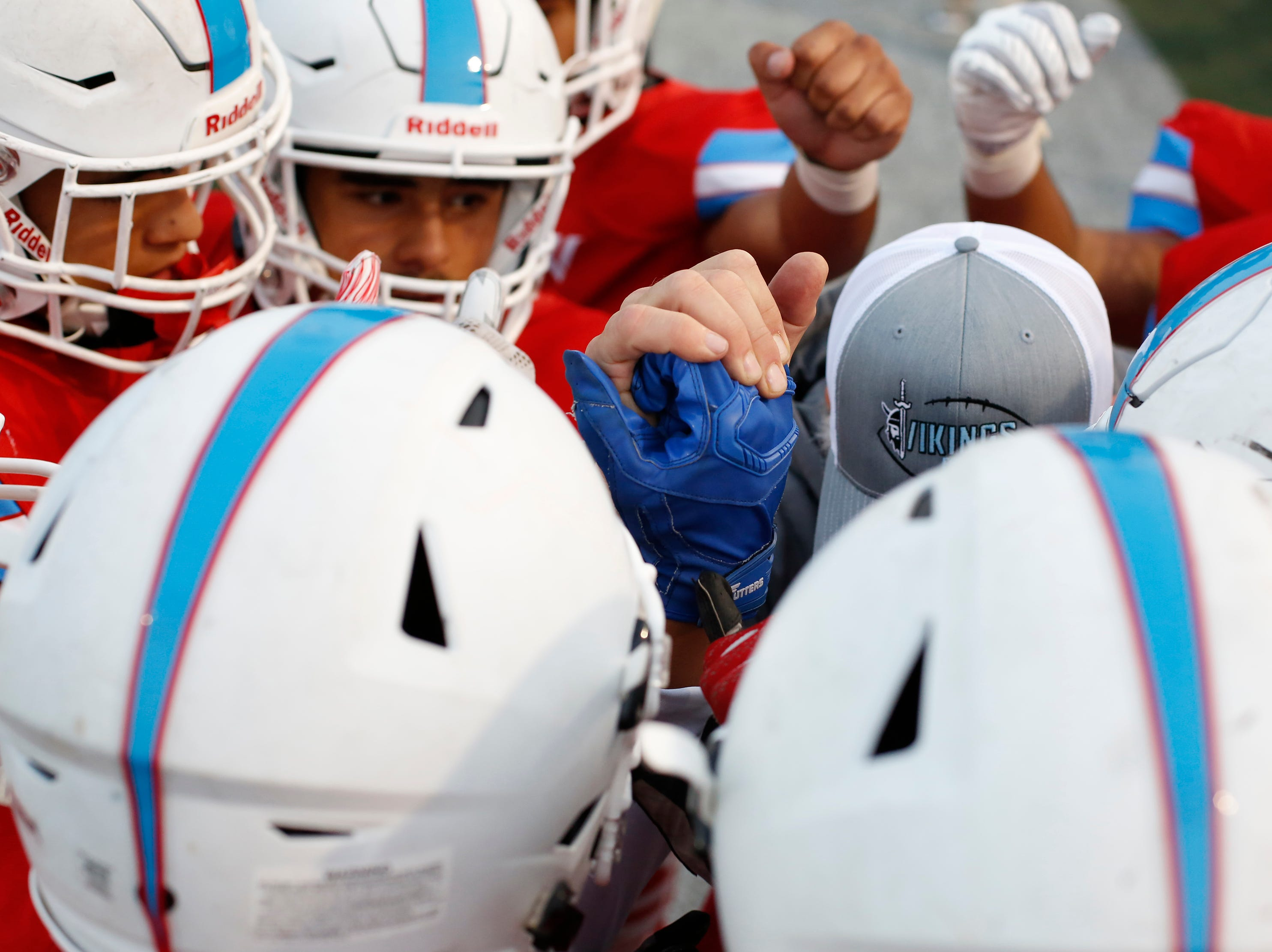North Salinas players huddle up before taking the field against North Monterey County during football at Rabobank Stadium in Salinas on Thursday August 23, 2018.