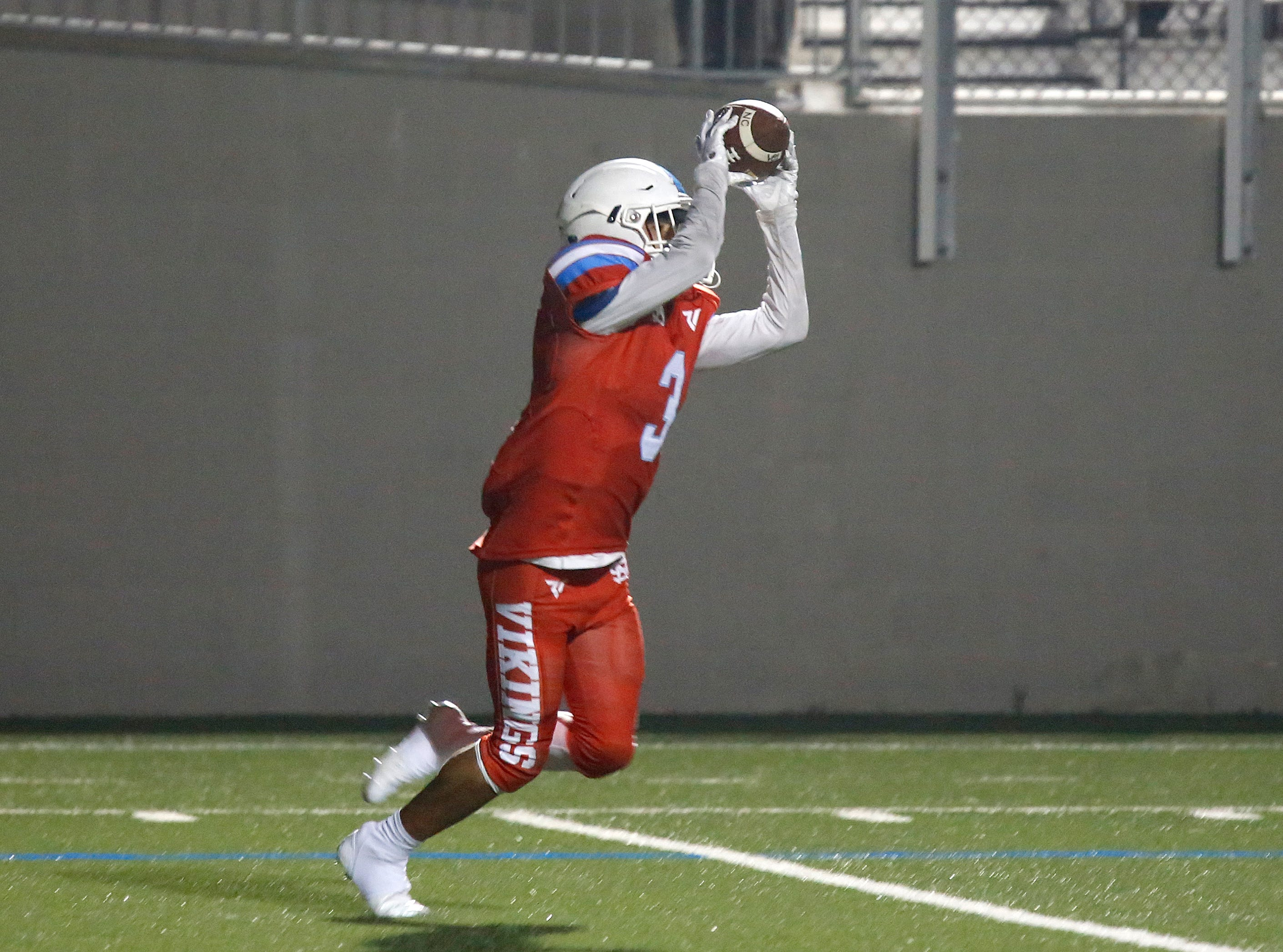 North Salinas's Manuel Camberos reels in an interception against North Monterey County during football at Rabobank Stadium in Salinas on Thursday August 23, 2018.