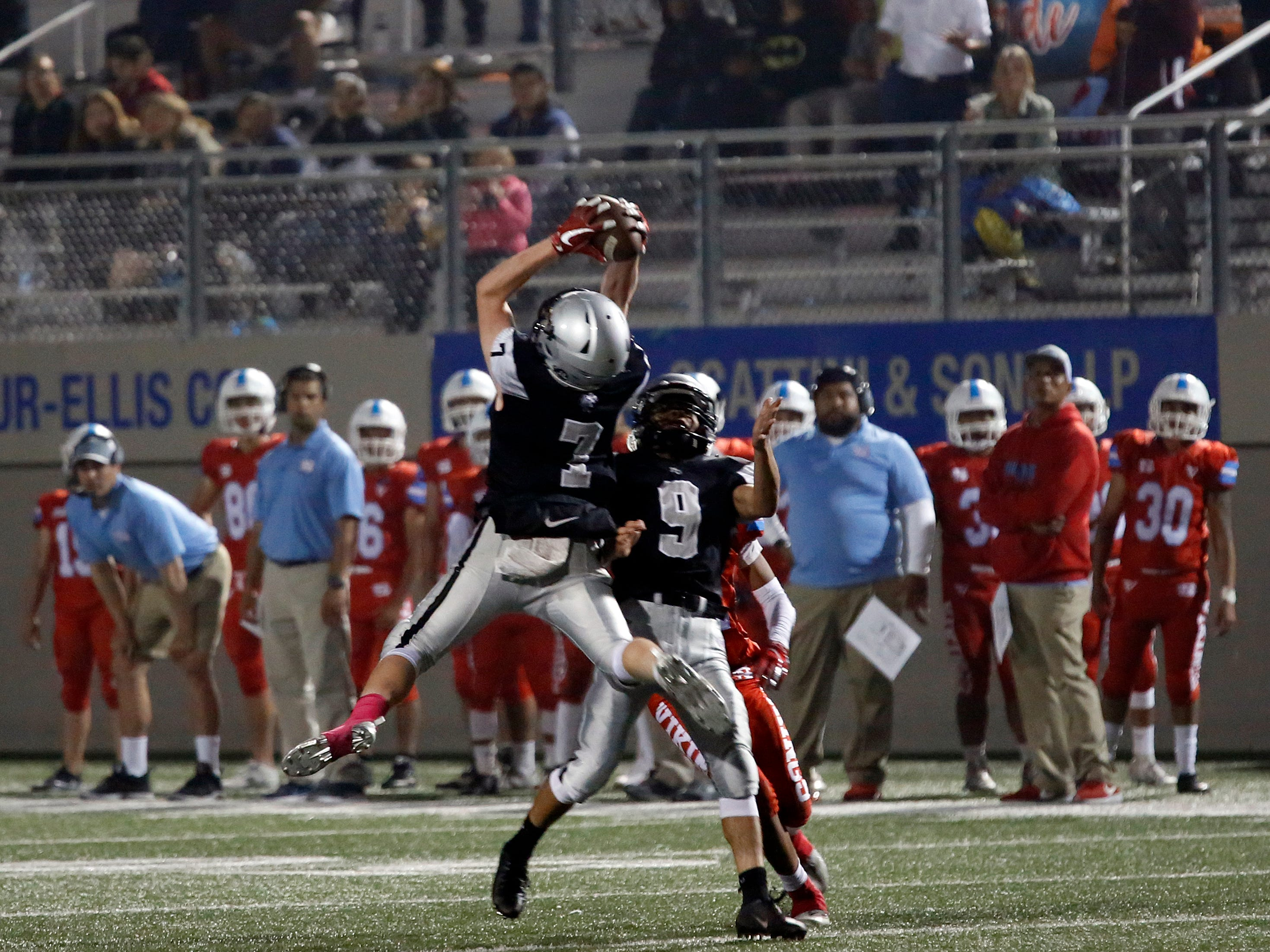 North Monterey County's Riley Anderson makes an interception against North Salinas during football at Rabobank Stadium in Salinas on Thursday August 23, 2018.