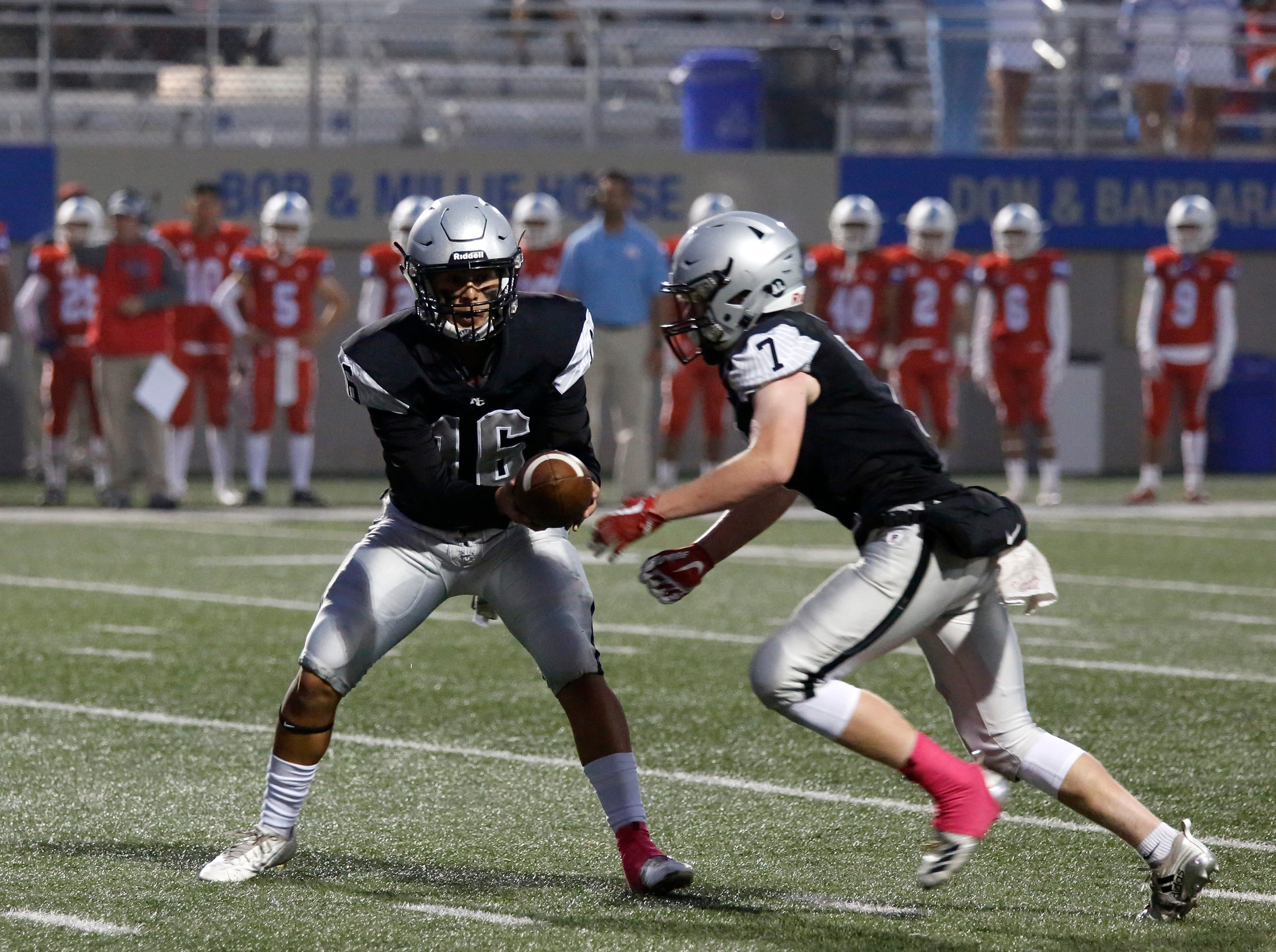 North Monterey County quarterback Brandon Ducusin hands the ball to Riley Anderson against North Salinas during football at Rabobank Stadium in Salinas on Thursday August 23, 2018.