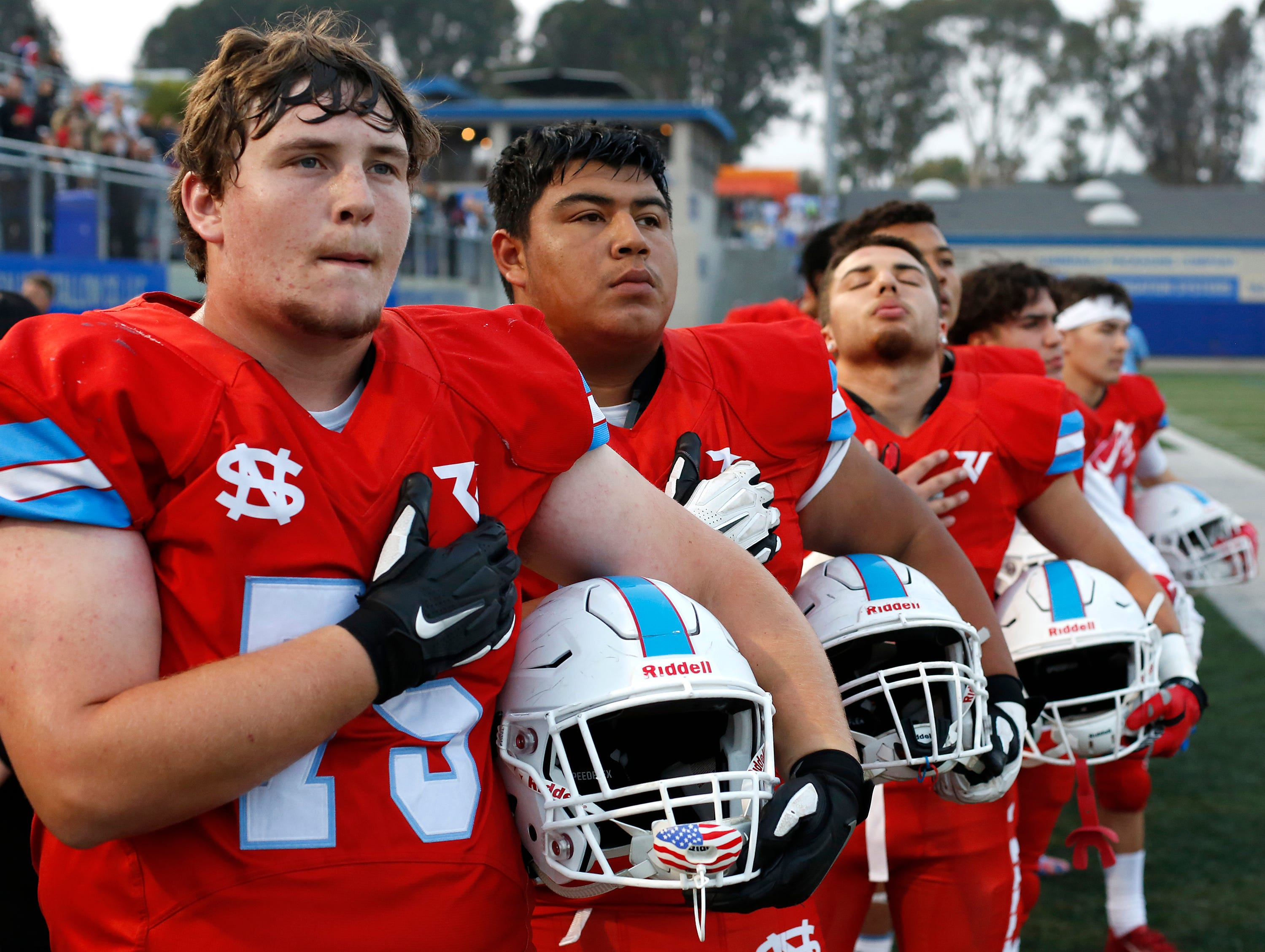 North Salinas players listen to the national Anthem before taking the field against North Monterey County during football at Rabobank Stadium in Salinas on Thursday August 23, 2018.