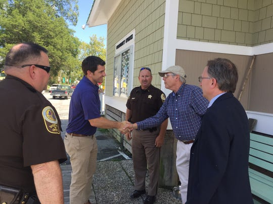 Rep. Scott Taylor shakes hands with Onancock Mayor Fletcher Fosque during a visit to Onancock, Virginia on Friday, Aug. 24, 2018.