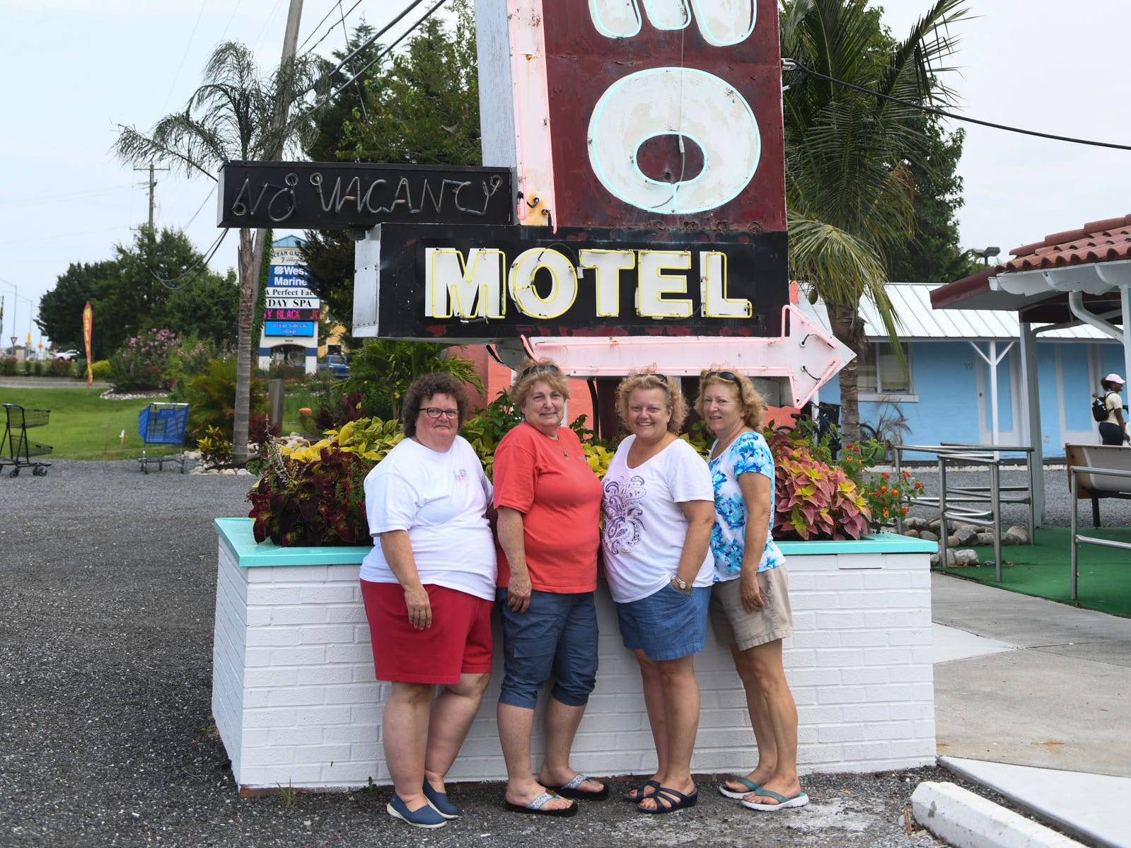 Rebecca Kunz, 57, of Point of Rocks, Md., Sue Jones, 65, of Sykesville, Md., Melinda Bassett, 62, of Jefferson, Md., and Jennifer Sasso, 60, of Milford, Conn., pose in front of the Alamo Motel in West Ocean City. Their great uncle, Bill Weaver, founded the business in 1946.