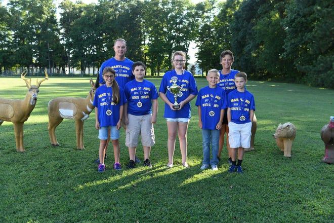 Holly Grove's archery team won their second world championships. MacKenzie Eby, 5th, Bruce Bowden, Coach, Ethan Mackley, 4th, Samantha Porter, 5th, Aidan Lang, 4th, Marlene Parks, Athletic Director, and Logan Widdowson 4th.