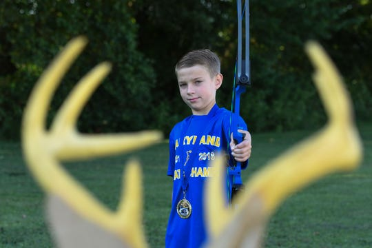 Logan Widdowson, 4th grade, helped Holly Grove archery team win their second world championships.