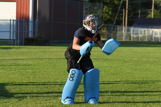 Crisfield field hockey sophomore goalie Taylor Swann works on drills during practice on Thursday, August 24, 2018.