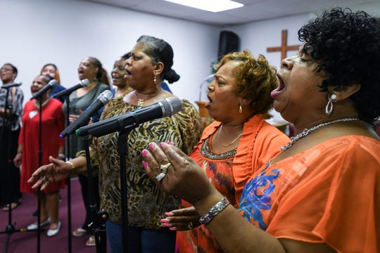 Rev. Deborah Collins, Rev. Barbra Frisby and Rev. Gwen Waters (right to left) sing with the Veney Gospel Singers of Salisbury, MD during a rehearsal for their 50th anniversary concert, which will take place on September 8th at 5 p.m.