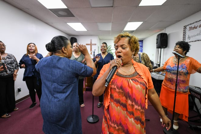 Choir director Pat Chase (left) and Rev. Barbra Frisby, lead the Veney Gospel Singers of Salisbury, MD in song at a practice for their 50th anniversary concert.