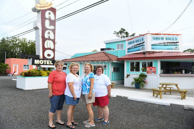 Sue Jones, 65, of Sykesville, Md., Melinda Bassett, 62, of Jefferson, Md., Jennifer Sasso, 60, of Milford, Conn., and Rebecca Kunz, 57, of Point of Rocks, Md., pose in front of the Alamo Motel in West Ocean City. Their great uncle, Bill Weaver, founded the business in 1946.