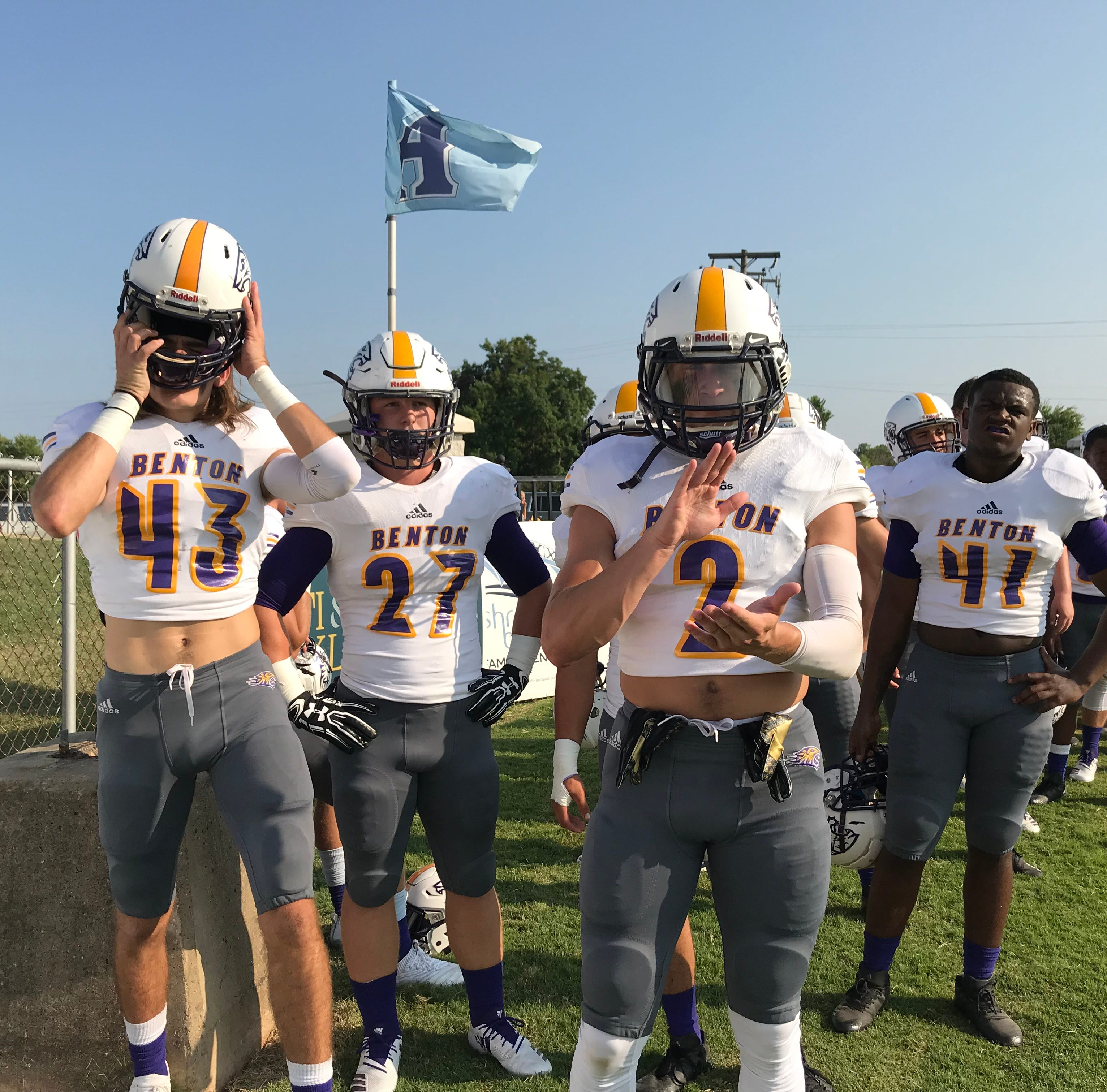Led by Michael Schoth (42), Cole Horton (27), Legend Denler (2) and Kershun Shepard (41) the Benton Tigers prepare to take the field against Airline Friday night in the Bossier City Lions Club Jamboree.
