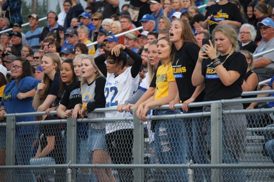 Dakota State students cheer for their team Thursday night at Joe Quintal Field