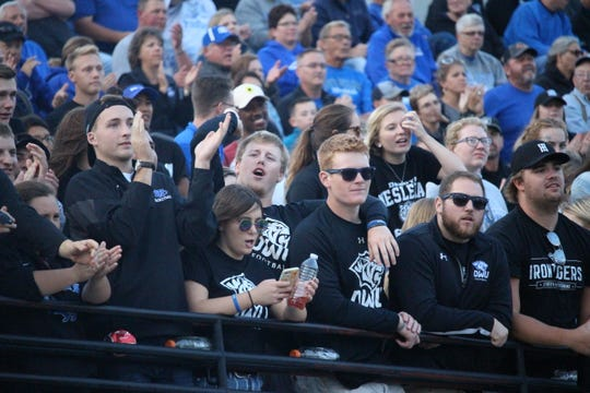 Dakota Wesleyan students root for the Tigers Thursday night at Joe Quintal Field