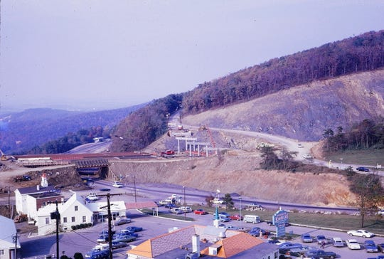 Construction of the final segment of I-64 over Afton, 1970.