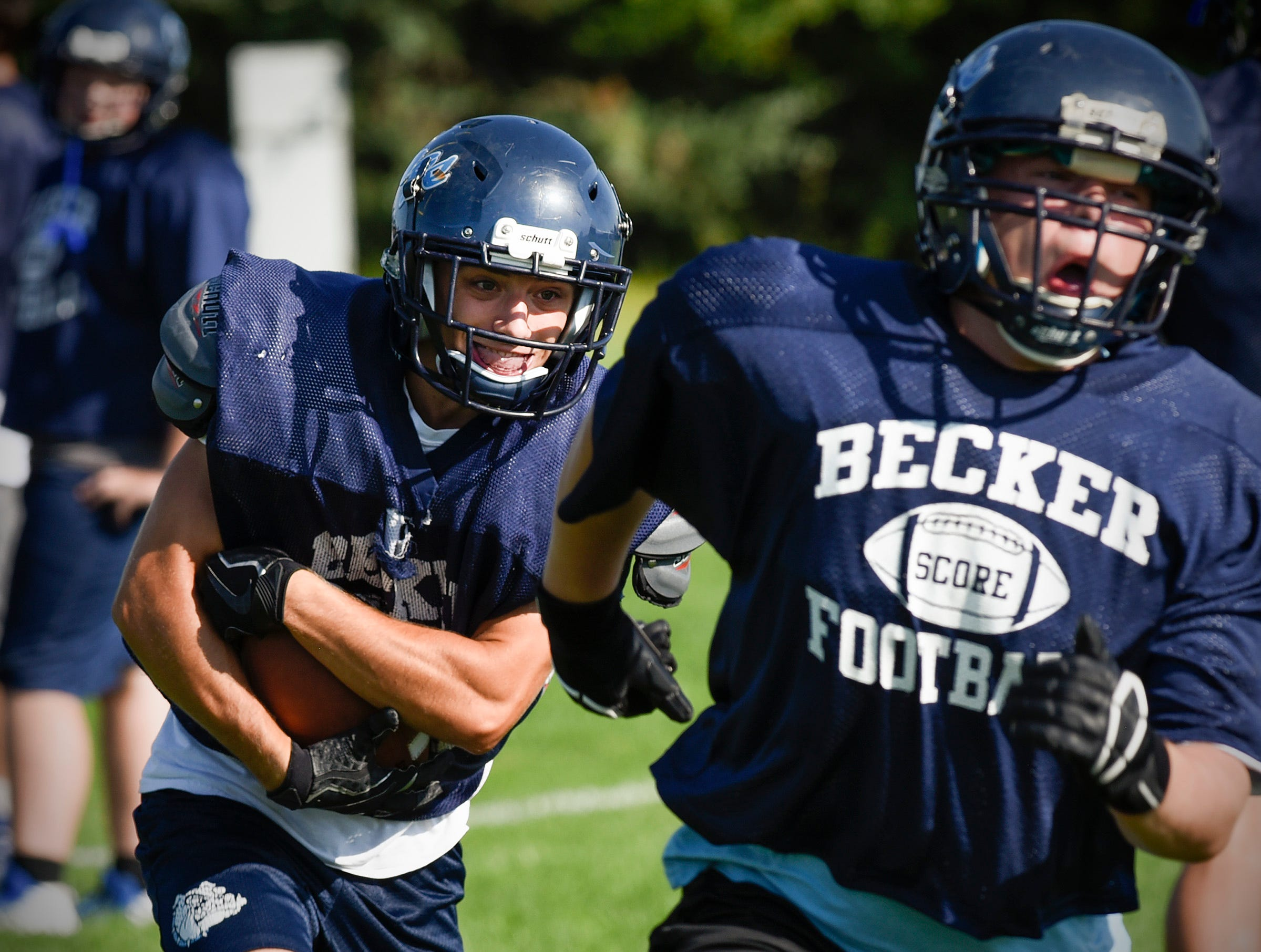 Becker back Kevin Andres finds room to run during practice Wednesday, Aug. 22, at the Becker High School.