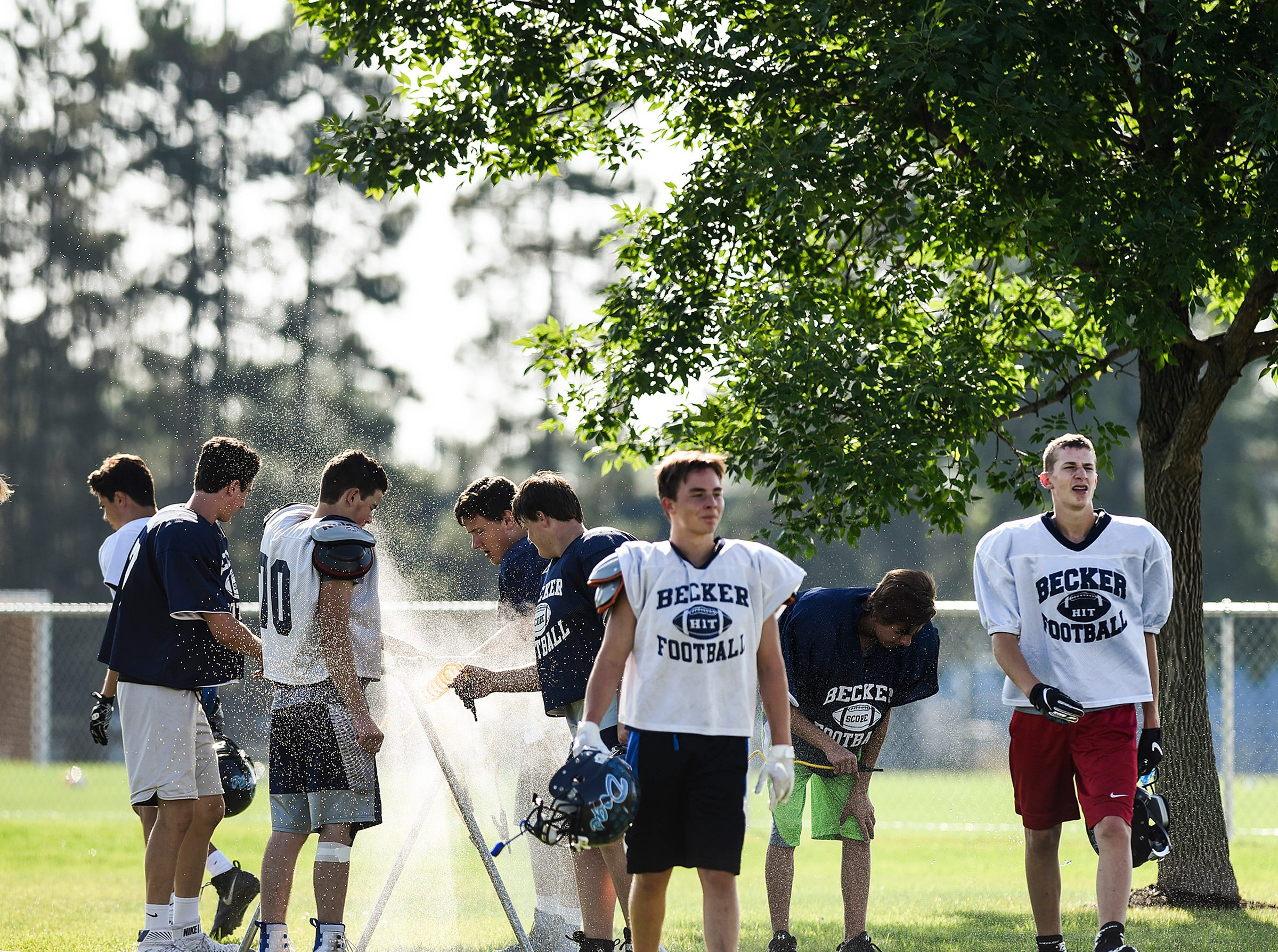 Becker players take a water break during practice Wednesday, Aug. 22, at the Becker High School.