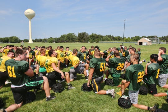 Quarterback Cade Milton leads the Storm as they wind down after their morning practice Wednesday, Aug. 15, at Sauk Rapids-Rice High School.