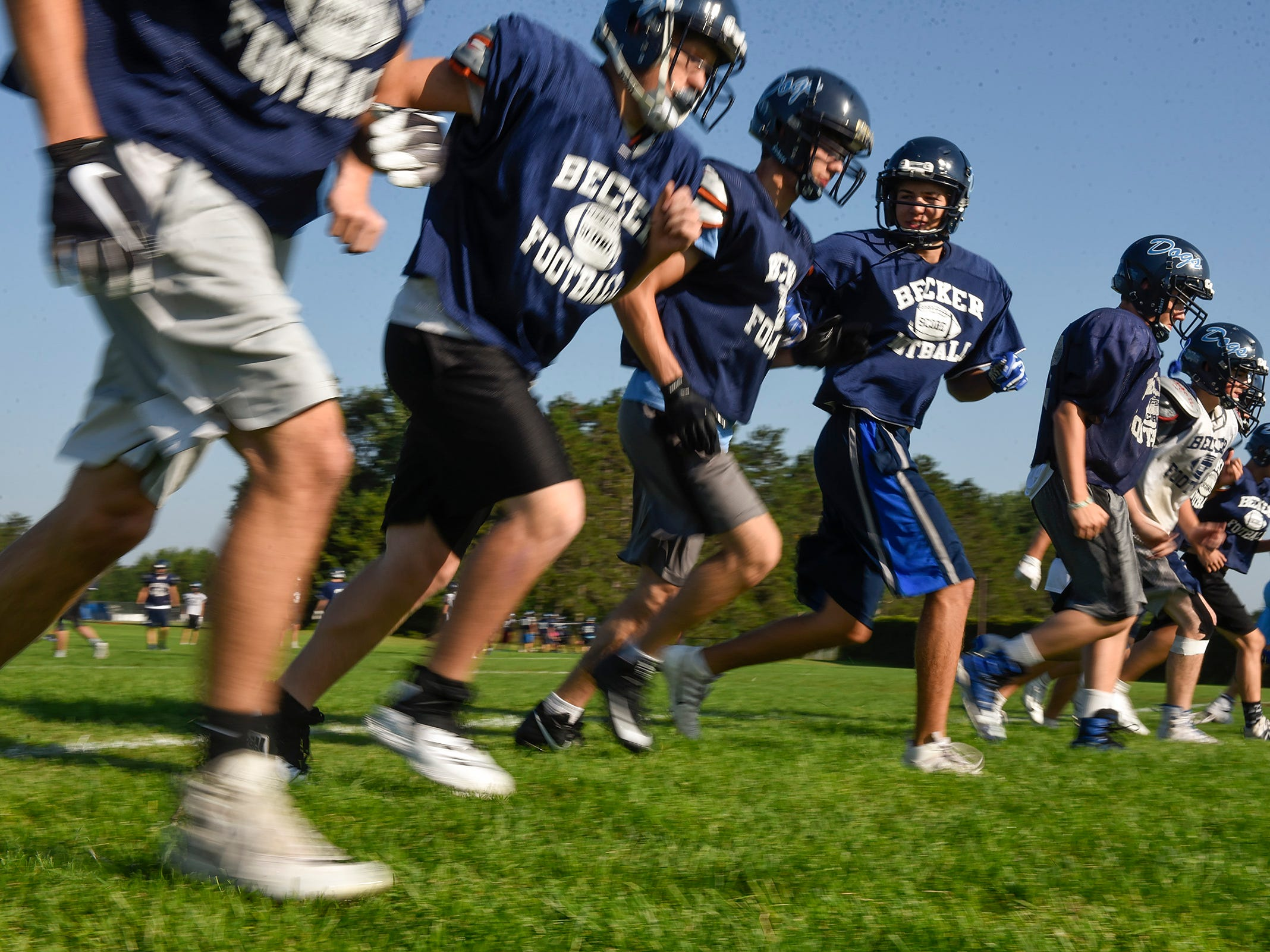 Becker players run conditioning sprints before a break Wednesday, Aug. 22, at the Becker High School.