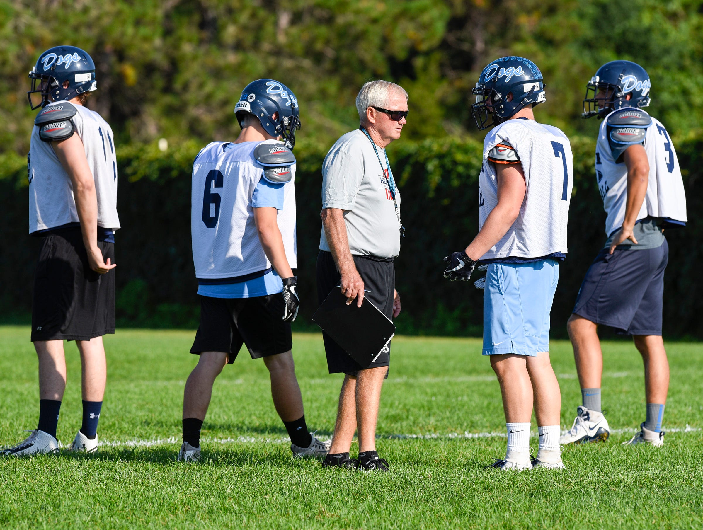 Becker coach Dwight Lundeen talks with players during practice Wednesday, Aug. 22, at the Becker High School.